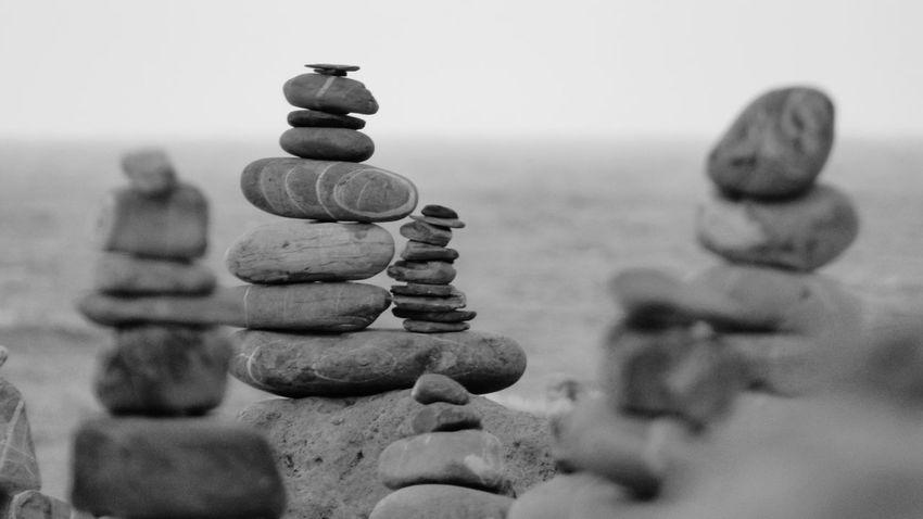 Sea Outdoors No People Close-up Water Sky Day Nature Arrangement Zen Stone Zen Stack Rocks Backgrounds Zen Rock On Beach Zen Rock At Beach Full Frame Beach Zen Stones Peace Rock - Object The Week On EyeEm In A Row Tranquility Balance Monochrome Black And White