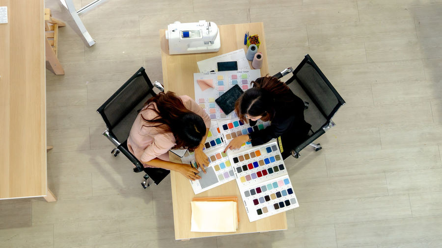 High angle view of woman working with colleague at creative office