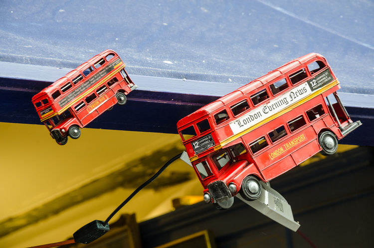 Model buses hang from the roof of a market stall on Portobello Road in London. Close-up Day Fire Engine Hanging Hung Land Vehicle London Bus Mode Of Transport Model Models No People Outdoors Red Red Toys Transportation