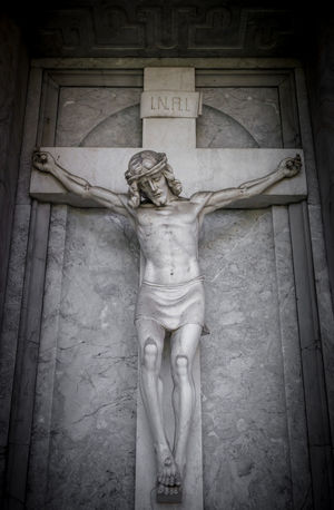 Crucifixion of Christ. The suffering of Jesus Christ (statue fragment religion). Ancient Antique Background Belief Bible Catholic Christ Christian Church Cross Crucifix Crucifixion Death Easter Face Faith Fragment God Graveyard Holy Hope INRI Jesus Life Love