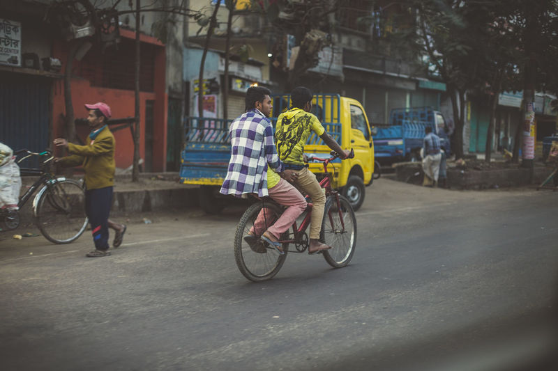 Colourful Strangers Bangladesh Bicycle Chittagong City City Life Cyclist Day Land Vehicle Lifestyles Mode Of Transport Outdoors The Street Photographer - 2016 EyeEm Awards My Commute Feel The Journey People Together CyclingUnites This Is Masculinity Visual Creativity
