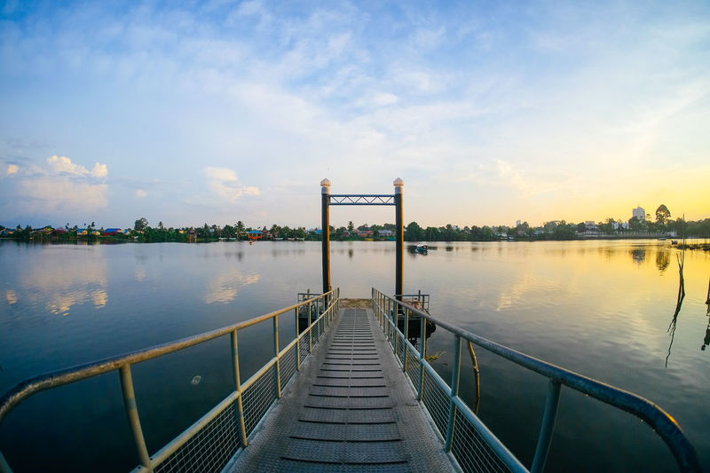 Beautiful scenery while on the jetty in the morning in Kuching, Malaysia Beauty In Nature Cloud Cloud - Sky Diminishing Perspective Empty Idyllic Jetty Nature No People Outdoors Pier Reflection Relaxing Scenics Sky Sunset The Way Forward Tranquil Scene Tranquility Vanishing Point Water EyeEmNewHere