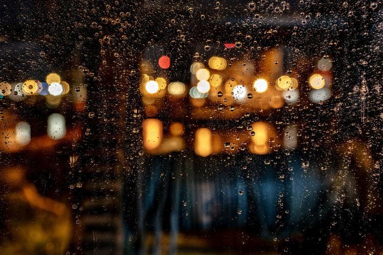 Close-up of wet glass window in rainy season