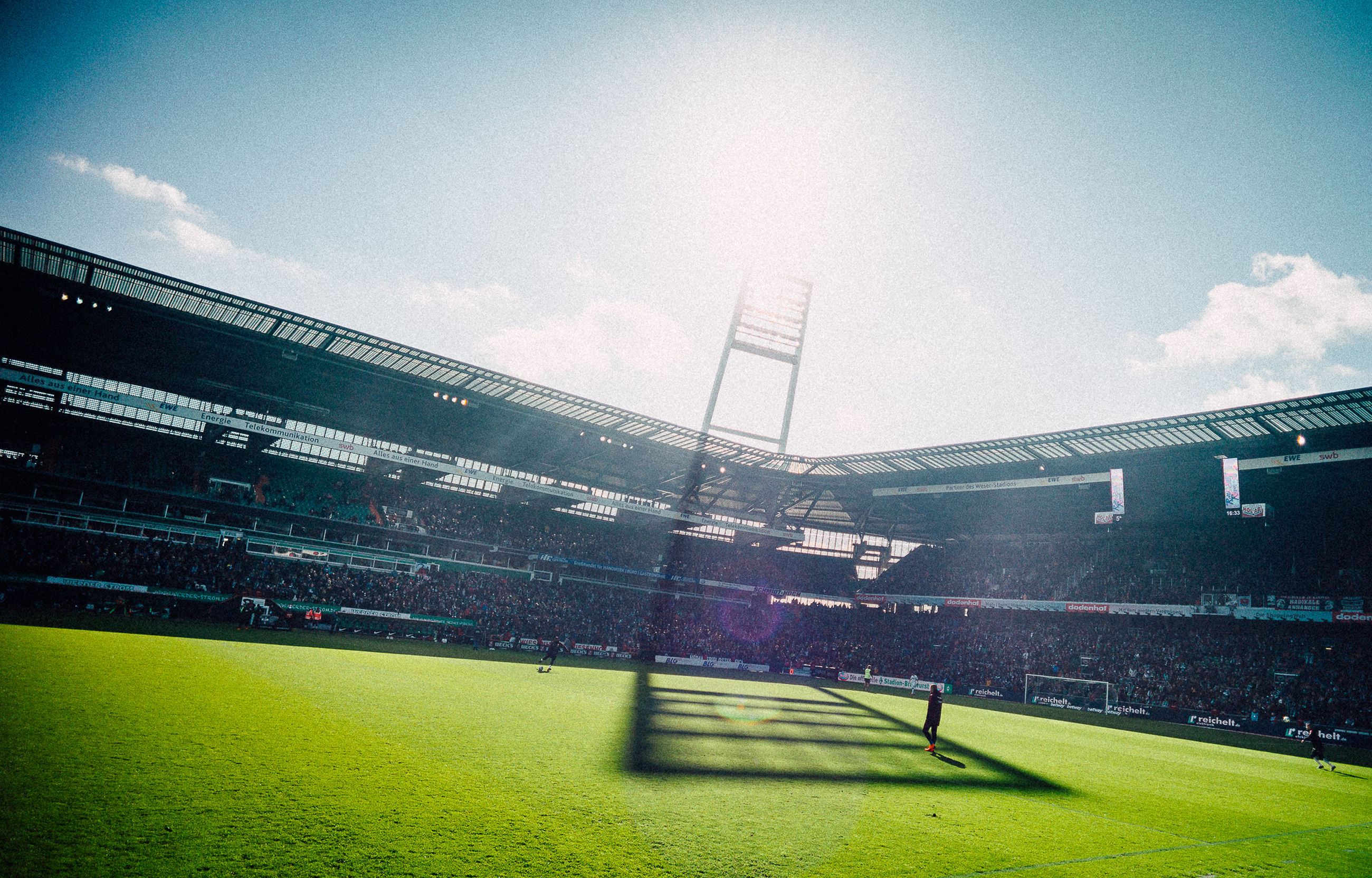 grass, stadium, sky, sport, soccer, team sport, nature, cloud - sky, day, competition, competitive sport, plant, soccer field, sunlight, playing field, crowd, outdoors, group of people, spectator, floodlit