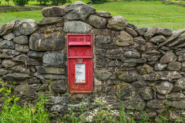 Public mailbox on stone wall