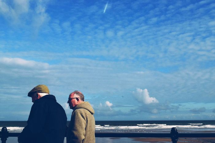 Sky Cloud - Sky Sea Outdoors Real People Two People Day Nature Water Warm Clothing Senior Men People People Watching Urbanphotography Taking Photos Eye4photography  EyeEm Gallery Exploring Sky And Clouds Blue Blue Sky