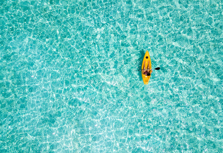 Directly above shot of woman kayaking in sea