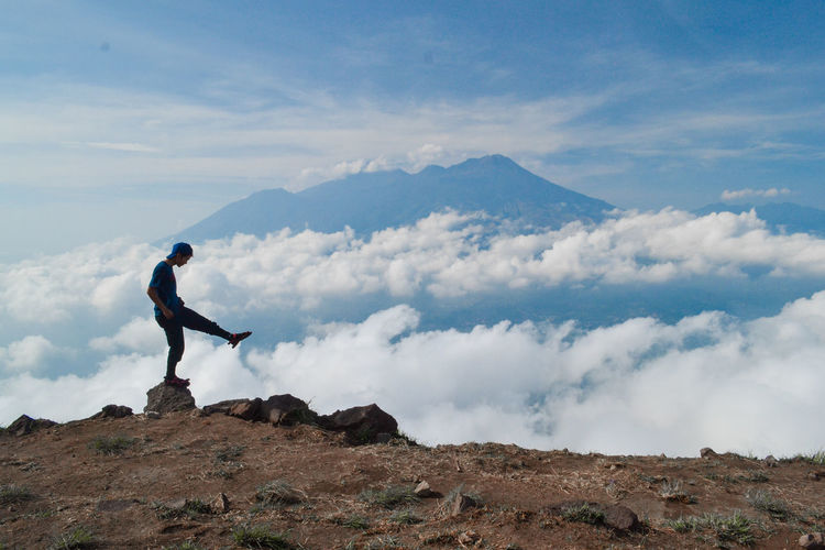 One Person Sky Mountain Scenics - Nature Cloud - Sky Full Length Leisure Activity Beauty In Nature Real People Lifestyles Standing Rock Solid Tranquil Scene Side View Tranquility Land Environment Rock - Object Outdoors