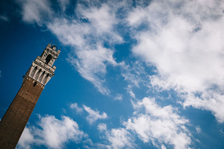 Low angle view of torre del mangia against sky
