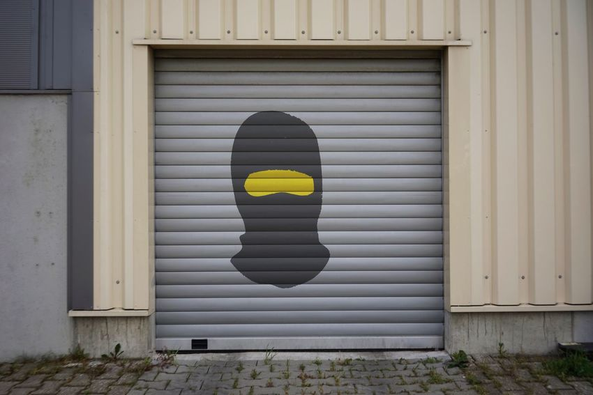 Mummed Graffiti Architecture Closed Built Structure Entrance No People Building Exterior Wall - Building Feature Door Day Outdoors Shutter Symbol