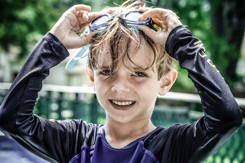 Portrait of cute boy wearing swimming goggles