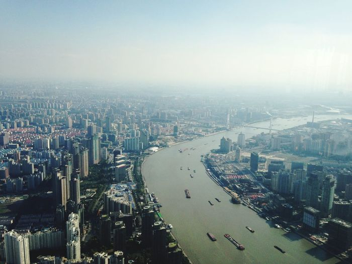 Aerial View Of Huangpu River Amidst Buildings In City