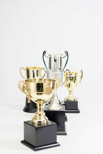 Variety of Trophy Cup on white background Trophy AWARD Studio Shot Success Winning Indoors  Achievement White Background Still Life Metal Shiny No People Copy Space Competition Gold Colored Cut Out Cup Single Object Close-up Pride Silver Colored