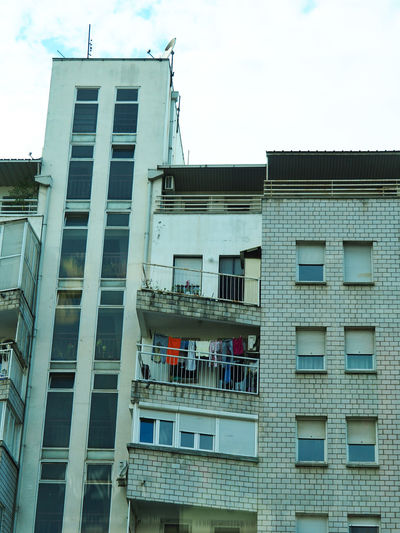 European Cities Patterns Building Apartment Glass - Material No People Window Balcony Cloud - Sky Low Angle View Residential District Day City Built Structure Architecture Building Exterior Travel Destinations Street Photography Outdoors Balkans Europe Eastern Europe Serbia Belgrade Hanging Laundry