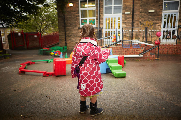 First day of school First Day Of School Child Childhood Children Only Eager Full Length Girls Lonley Girl One Girl Only One Person Outdoors Playground Playing Raincoat Real People Rear View