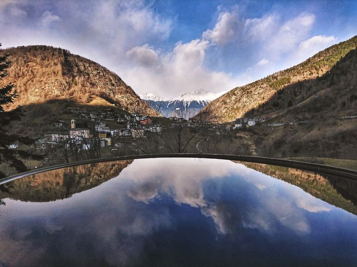 Scenic view of lake and mountains against sky, val tartano.