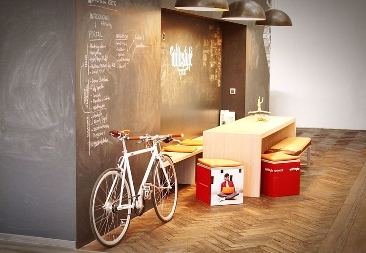 Wildstylers Social Hub with a huge Chalkboard Wall invites everyone to participate in the process. Creativity Agency Officedesign Daylight