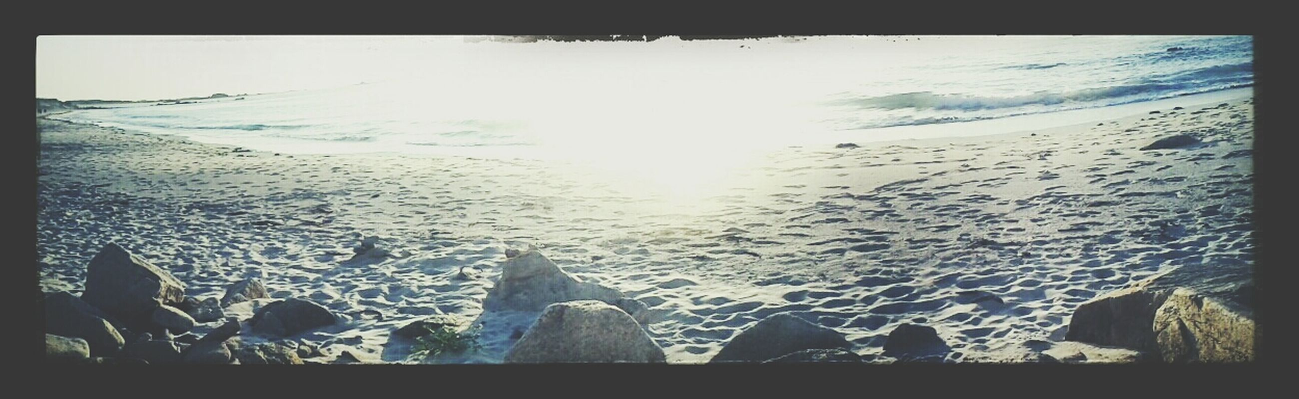 transfer print, sea, auto post production filter, water, beach, scenics, beauty in nature, tranquil scene, nature, tranquility, shore, horizon over water, sunlight, panoramic, vacations, sky, silhouette, sand, tourism, idyllic