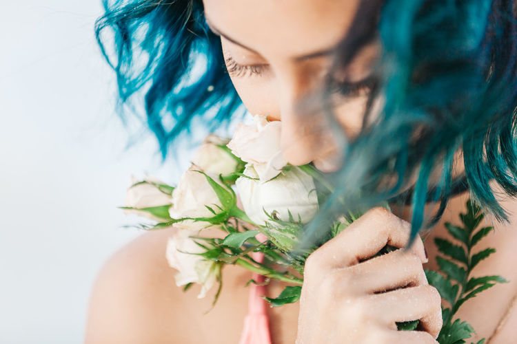 Close-up of woman with flowers in hair
