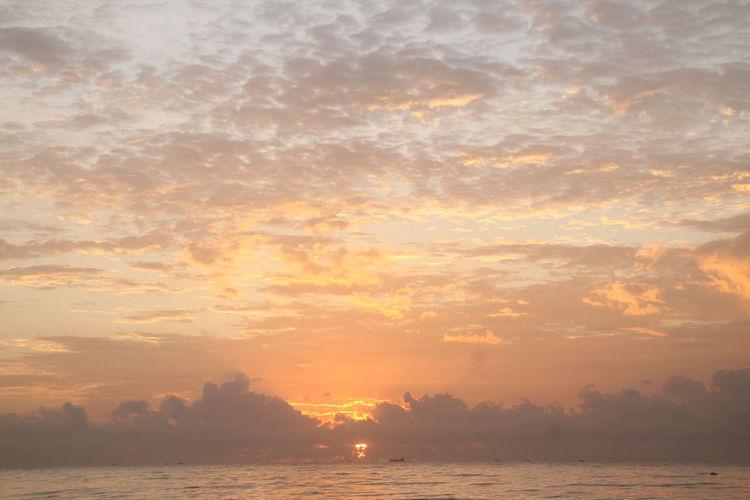 Sunrise at Manggar Beach Sky Sunset Cloud - Sky Beauty In Nature Tranquility Water Scenics - Nature Orange Color Tranquil Scene Nature Sea No People Sunlight Idyllic Sun Waterfront Outdoors Non-urban Scene Horizon Sunrise Beach Dusk Landscape View Cloud
