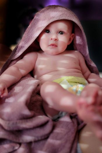 Portrait Of Cute Baby Wrapped In Towel