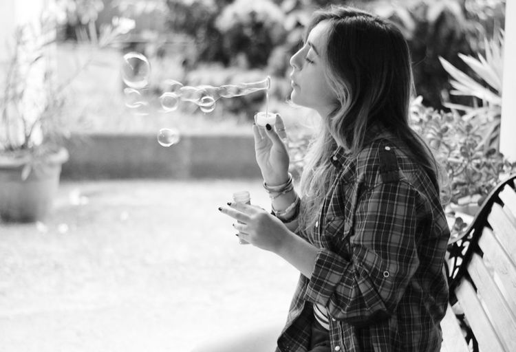 Full length of woman with bubbles