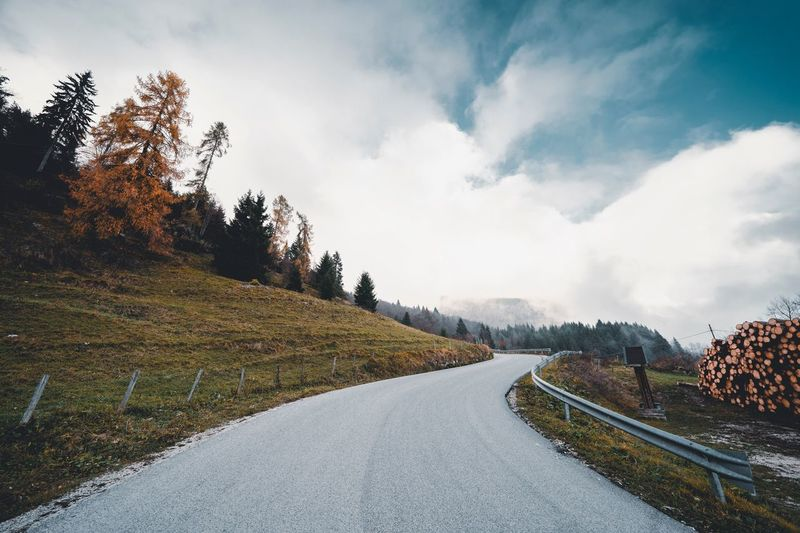 Italy Veneto Asiago Cloud - Sky Tree Sky Plant Transportation Nature Road Beauty In Nature The Way Forward Scenics - Nature No People Direction Environment Snow Tranquility Tranquil Scene Outdoors Winter Day Cold Temperature