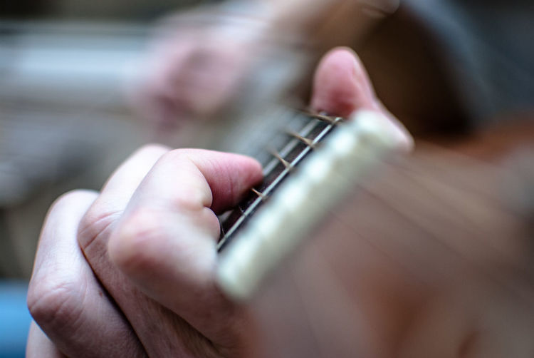 Close-Up Of Hands Of A Man Playing Guitar