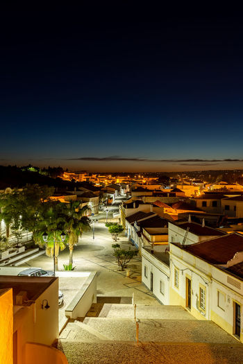 Castro Marim village, Algarve, Portugal Nightscape of Castro Marim Building Exterior Architecture Built Structure Building City Residential District High Angle View Sky Nature No People Town House Illuminated Cityscape Outdoors Clear Sky Community Copy Space Blue TOWNSCAPE