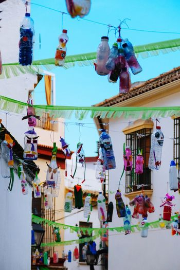 Low angle view of decorations hanging in market