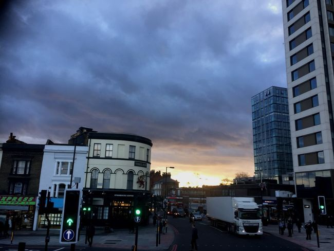 Archway from the top of the bus View From The Bus Moody Sky High Angle View Sunsets Traffic Lights North London City Suburb London Suburbs London Archway Cloudy Skies Cloudy Sky Endoftheday EyeEmNewHere Architecture Sky Cloud - Sky Built Structure Building Exterior City Street Sunset Road Outdoors