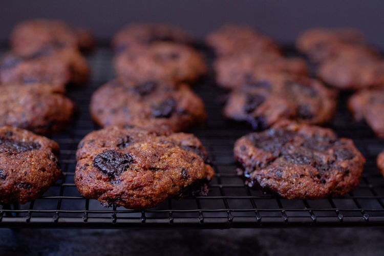 Paleo Chocolate Chunk Cookies on Baking Rack Chocolate Comfort Food Cookies Food Styling Food And Drink Freshly Baked Shadows & Lights Snack Temptation Chocolate Chip Cookies Close Up Close-up Cooling Rack Dark Photography Darkness And Light Food Food And Drink Food Photography Healthy Eating Healthy Food Healthy Lifestyle Indulgence Ready-to-eat Shadow Snacks
