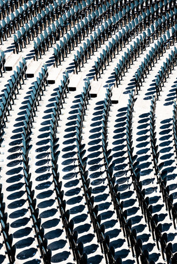 Chairs in the audience in the amphitheater opaque background Circle Seats In Row Theater Abstract Amphitheater Audience Auditorium Backgrounds Business Day Environmental Conservation Full Frame In A Row Industry Large Group Of Objects No People Open Space Order Pattern Repetition Round Seats Silver Colored Striped White Color