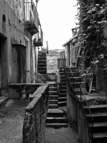 Glimpse with stairs Black & White Old Town Architecture Black And White Black And White Photography Building Exterior Built Structure Calabria Glimpse No People Outdoors Staircase Stairs Steps Steps And Staircases The Way Forward Travel Destination Verbicaro