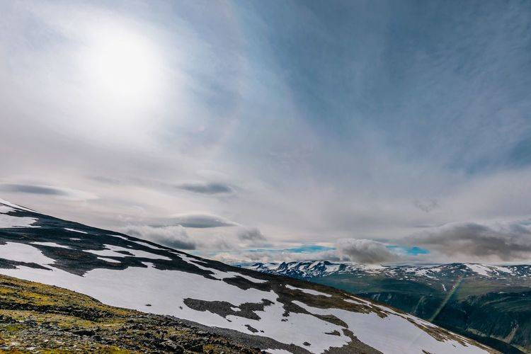 Sunshine at Jotunheimen in Norway EyeEm EyeEm Nature Lover Mountain Snow Dramatic Sky Sky Landscape Cloud - Sky Shining Mountain Range Snowcapped Mountain Tranquil Scene Sunbeam Scenics Mountain Peak Countryside Non-urban Scene Tranquility Sun Snowcapped Calm