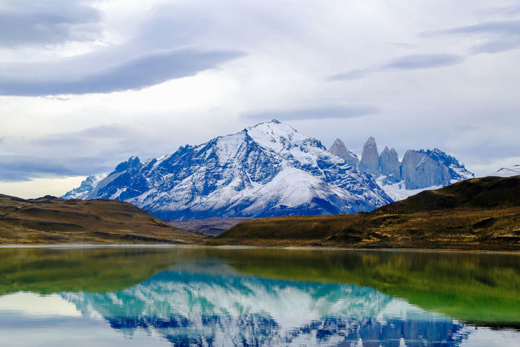 Patagonia Beauty In Nature Calm Cloud - Sky Day Idyllic Lake Majestic Mountain Mountain Range Nature Non-urban Scene Reflection Remote Scenics Sky Standing Water Tourism Tranquil Scene Tranquility Travel Destinations Vacations Water Waterfront Wilderness Wilderness Area