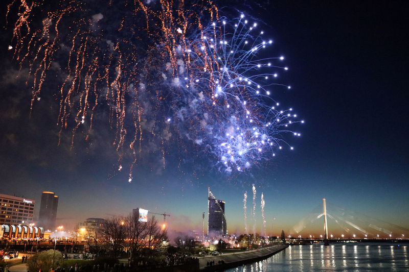 Architecture Building Exterior Built Structure Celebration City Cityscape Event Exploding Firework Firework - Man Made Object Firework Display Glowing Illuminated Long Exposure Low Angle View Night No People Outdoors Sky Skyscraper Travel Destinations Arts Culture And Entertainment Multi Colored