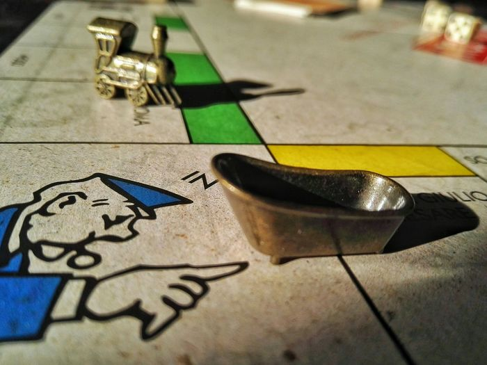 Indoors  Day Close-up Game Table Game Playing Games Monopoly Board Game Board Games Pawn Piece Tub Basin Vintage Vintage Game Board EyeEm Gallery Billboard Society Game Play Gioco Da Tavolo EyeEm Best Shots