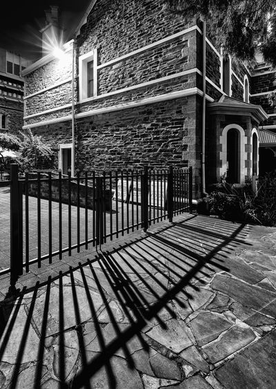 Architecture Building Building Exterior Built Structure Entrance Footpath Gate Night No People Railing Shadow