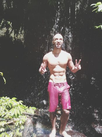 Water Shirtless Swimming Trunks Wet Swimming Full Length Pink Color One Person Outdoors Summer Front View Day Fun Refreshment Leisure Activity Vacations People Lake Swimming Pool Spraying