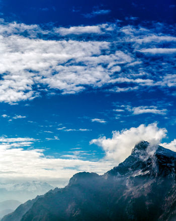 Beauty In Nature Blue Cloud - Sky Cold Temperature Day Low Angle View Mountain Mountain Range Nature No People Outdoors Scenics Sky Snow Tranquil Scene Tranquility Winter