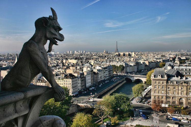 Gargoyle Statue Against City Scape