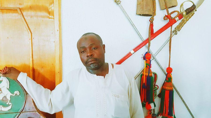 Portrait of man standing on clothesline