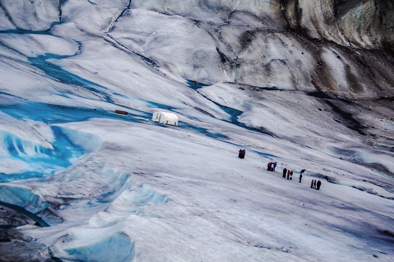 Tilt Shot Of People On Ice At Alaska