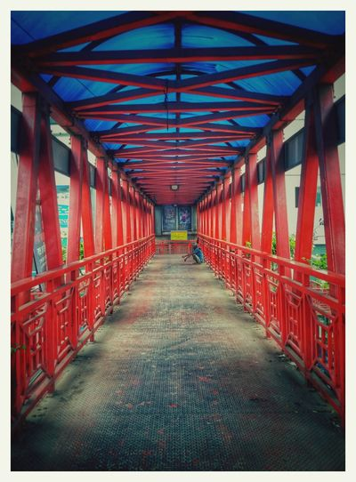 Footoverbridge Red Day Architecture The Way Forward Footbridge Loneliness Dhakagraam Mobilephotography Single Life  Symmetry Built Structure No People Travel Destinations Multi Colored Indoors