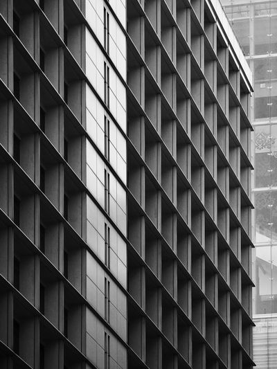 Building Exterior Window Architecture Pattern Built Structure Façade No People Day Outdoors Urban Geometry Abstract Olympus OM-D EM-1 Different Perspective Light And Shadow Black & White Black And White Lines And Patterns Low Angle View Different Points Of View Modern Architecture Urban Pattern, Texture, Shape And Form