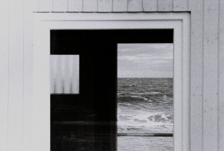 Close-up of sea seen through window