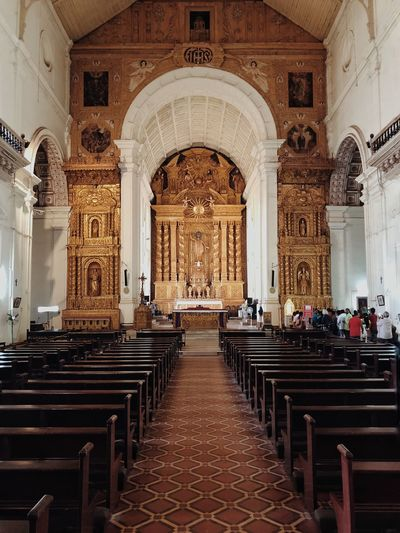 The Basilica of Bom Jesus Backgrounds Gotic Traveling ShotOnIphone Old Goa Goa Travel God Catholic SPAIN India Temple Church Basilica Jesus Place Of Worship Arch Building Pew Empty Chair Bench Ceiling Absence No People Altar Ornate Mural