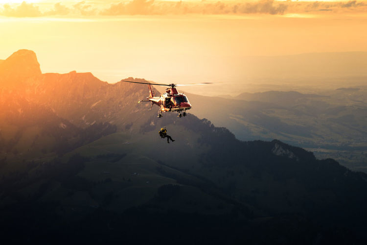 Adventure Beauty In Nature Day Extreme Sports Full Length Landscape Leisure Activity Lifestyles Men Mid-air Mountain Nature One Person Outdoors People Real People Scenics Silhouette Sky Sunset Go Higher