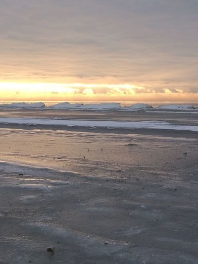 Shades Of Winter Sunset Beach Sea Beauty In Nature Dramatic Sky Horizon Over Water Nature Cloud - Sky Outdoors Wave Sky Sand No People Water Landscape Sun Orange Color